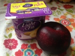 Yogurt and a plum.