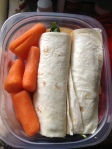 Carrots and a turkey wrap.