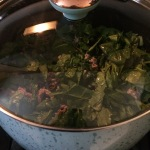 I add the spinach to the cooked meat and let it all kind of simmer.